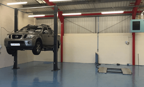 a pickup truck on a 2 post lift